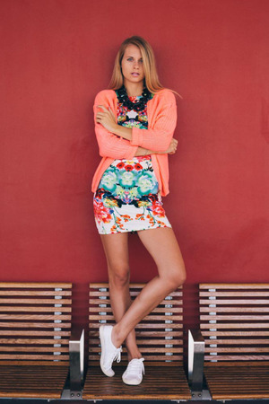 Dress, featuring round neckline, sleeveless, colorful blooming flowers print throughout, bodycon styling.