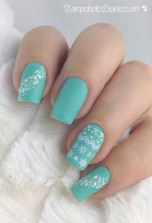 http://stampoholicsdiaries.com/2015/01/02/winter-nail-art-with-konad-essence/