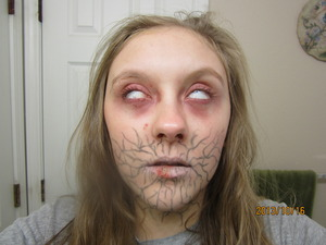 Boo! I scared my self when I as going through my pictures this morning. Something I decided to do for fun. The lines are the demon seeping into the victim.
