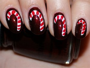 Candy Cane Nails Nail tutorial & more photos here: http://www.swatchandlearn.com/nail-art-tutorial-candy-cane-nails/