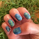 Blue with accent floral nail.