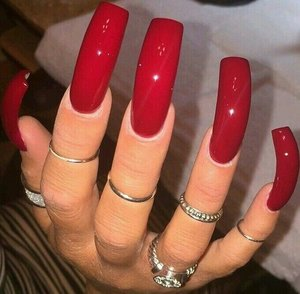 Having dealt with my nails at various lengths, I've finally got what I call Goldilocks nails. Not too long; not short, but just right. Wearing them with a traditional red polish and glossy top-coat, I get a high-fashion look and feel, balanced of elegance with practicality.