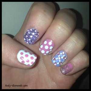 Quick and cute nail art of the day using pink and purple rhinestones, glitter fade, and polka dots