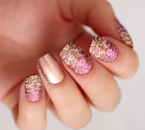 More info & a tutorial here: http://www.lacquerstyle.com/2014/05/gradient-baroque-nails-tutorial.html