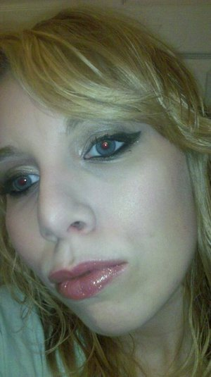 Super winged out liner, neutral eyes, bright lip!