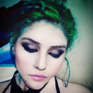 dark smoky eye, white eyeliner applied on waterline, you can't really tell in the picture but i had ombre lips pink and pale, center to the outer sides, and basic contouring, nose and cheeks.