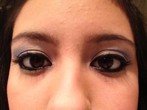 With dark eyeliner