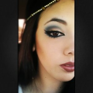 blue, brown, and gold shadow with a neutral lip.