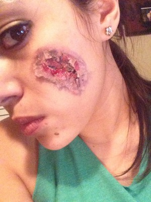 Special effect makeup, bloody wound on face.