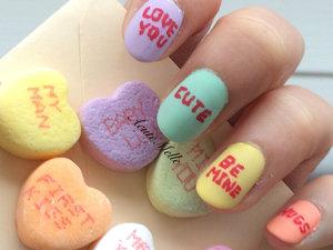 Candy hearts inspired nail art design Tutorial here: https://www.youtube.com/watch?v=Kui8hPZGf48