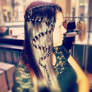 this is a zig zag braid. she got curls of her own so i had to straight it first