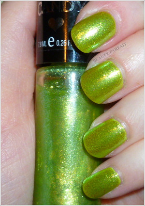 A combination of Sally Hansen Xtreme Wear in B-Right On! as the base and Hardy Candy Itzy Glitz in Teeny Greeny as the overlay.