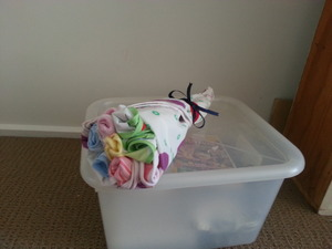 """""""Flower Bouquet"""" is made from: - Changing mat - Bibs - Burp Cloths - Wash Cloths  So quick and easy to make! Let me know if you'd like a tutorial"""