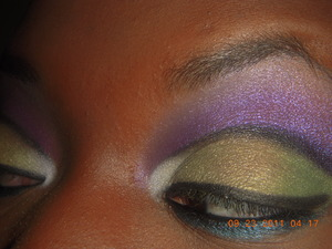 Green and purple cut crease http://www.youtube.com/user/lucky2HaveYOuORM?feature=mhee