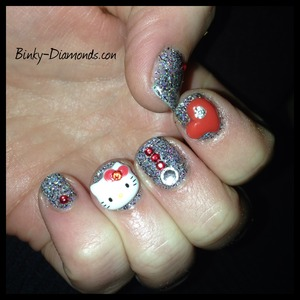 Sparkly holographic gel with Hello Kitty, Hearts and rhinestones.