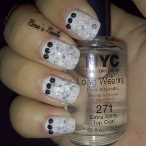 Sheer cream white base topped with a chunky black and white glitter. Encapsulated with the same sheer cream white. Accented with black pearls.