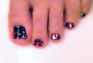 my own personal pedicure, deep purple with colorful sparkles on top