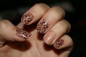 Konad m57 stamped with Revlon Hot for Chocolate over Sally Hansen Cafe Au Lait.