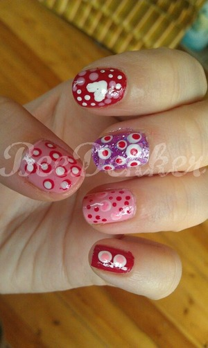 I created every design here using a light pink polish, red, white and purple sparkle as well as a dotting tool.