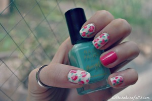 Go to http://www.asthesakurafalls.com/2012/05/30/tutorial-vintage-rose-nail-art/ for a full tutorial! :D