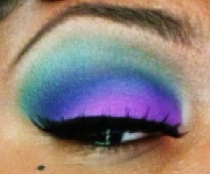 I blended dark purple & dark green in my crease. I used a purple/pink on my lid. I blended a dark green VERY LIGHTLY on my brow bone. ** I also used NYX eye pencil in 'milk' as a base.
