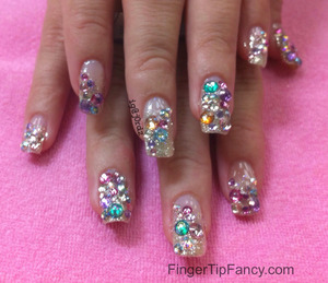 DETAILS HERE:  http://fingertipfancy.com/multi-rhinestone-nails