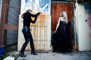 Was this model misbehaving??  Here designer Lora D. is fanning the model (trying to create a wind effect)