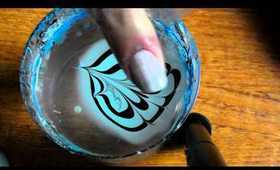blue and black water marble nail art tutorial