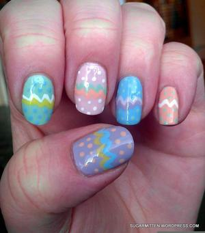 http://sugarmitten.wordpress.com/2012/04/05/pastel-skittles-with-easter-egg-nail-art/