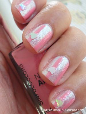 http://ladyluckbeauty.blogspot.com/2013/01/stripes-with-love-tutorial.html