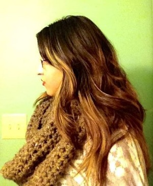 A gold, reddish brown base ombré with honey blonde highlights