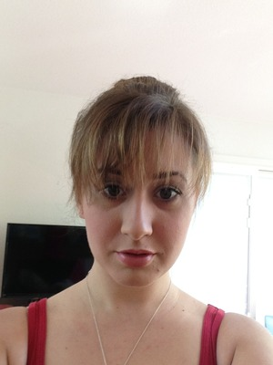 Simple makeup with pretty bangs and a delicate bun