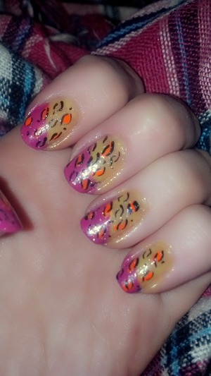 Yellow and pink with a splash of orange, with leopard print, topped off with a glitter top coat