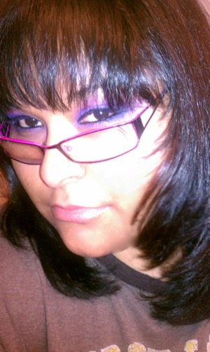 Purple and pink eye shadow with a thin liner and a nude lip