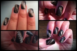 Black and gold nails, with rhinestone and chain decoration