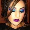Blue and purple eye makeup with plum lips