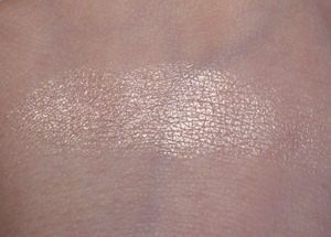 Revlon Pure Confection Highlighting Powder on skin.