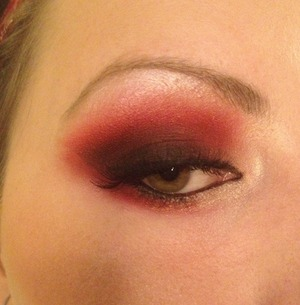 Deep red, brown and black eyeshadow blended out
