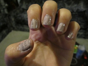 1. Paint nails with a light colored polish 2. Dip nails in rubbing alcohol for a few seconds (or you can press down with an alcohol pad like I did) 3. Use a strip of newspaper and press down firmly for 10-15 seconds. 4. Apply a base coat. (VERY important!!)  Voila! Super cute and easy newspaper nails :)