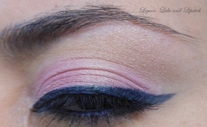 Pale pink combined with a navy blue cat eye.