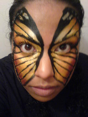 A simple butterfly using face paint and eye shadows