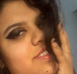 some mascara n lots of liner ! not to forget the lipgloss! and my totally impossible hair today!