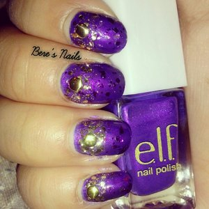 Purple jelly base sandwiched a glitter in between. Added a gold glitter gradient around the cuticles and accented all the nails with a round gold stud.