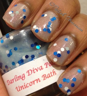 Sheer blue shimmery base with white and blue hex glitter.