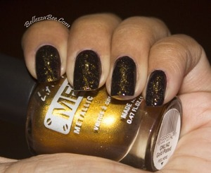 Gold saran wrap over Chocolate brown http://www.bellezzabee.com/2013/04/nail-challenge-day-9-golden-chic-saran.html