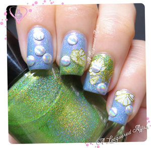 Floral-esque nail art using nail art stickers and holographic metal studs from Born Pretty Store, over holo polishes by Pretty Jelly and Lilypad Lacquer.