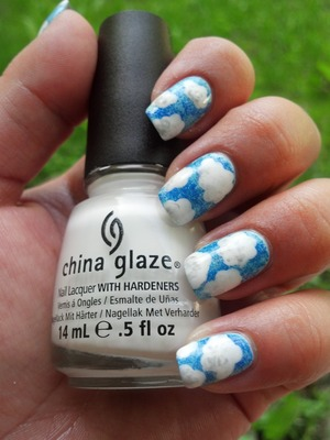 Clouds inspired by this tutorial http://www.beautylish.com/v/rurpvw/blue-skies-and-clouds-nail-art-tutorial