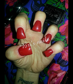 red acrylic on short flare tip nails