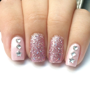 A girly manicure with pink, pink glitter and random shape rhinestones! <3