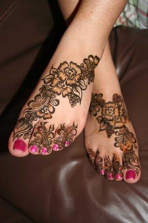 Fuschia nail polish with henna design :)